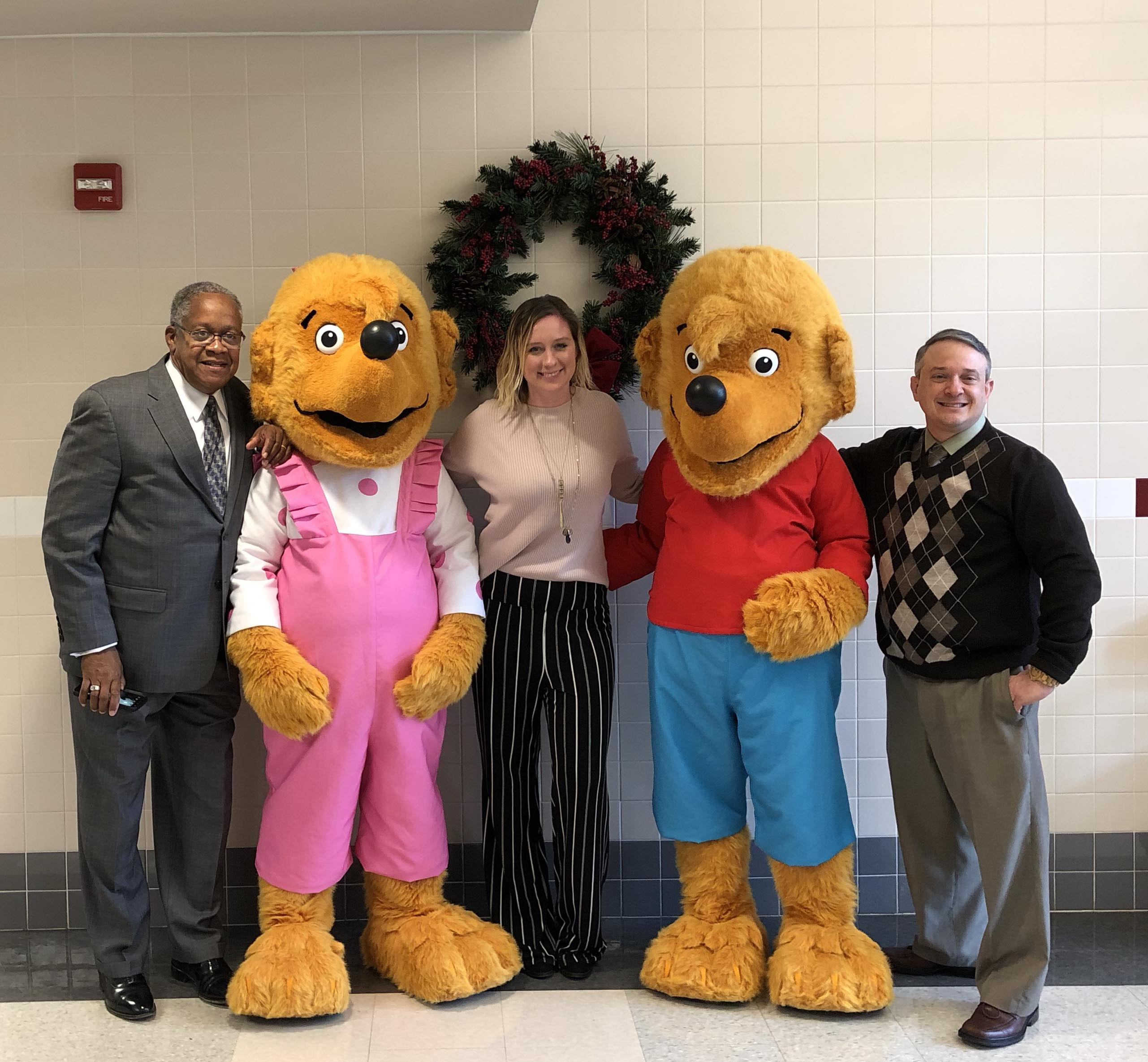 brother and sister bear with school administration