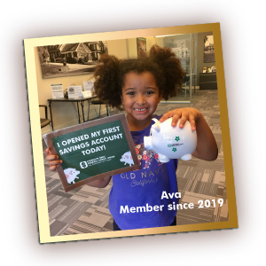 girl holding cub account sign